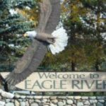 Welcome to Eagle River sign in Alaska.